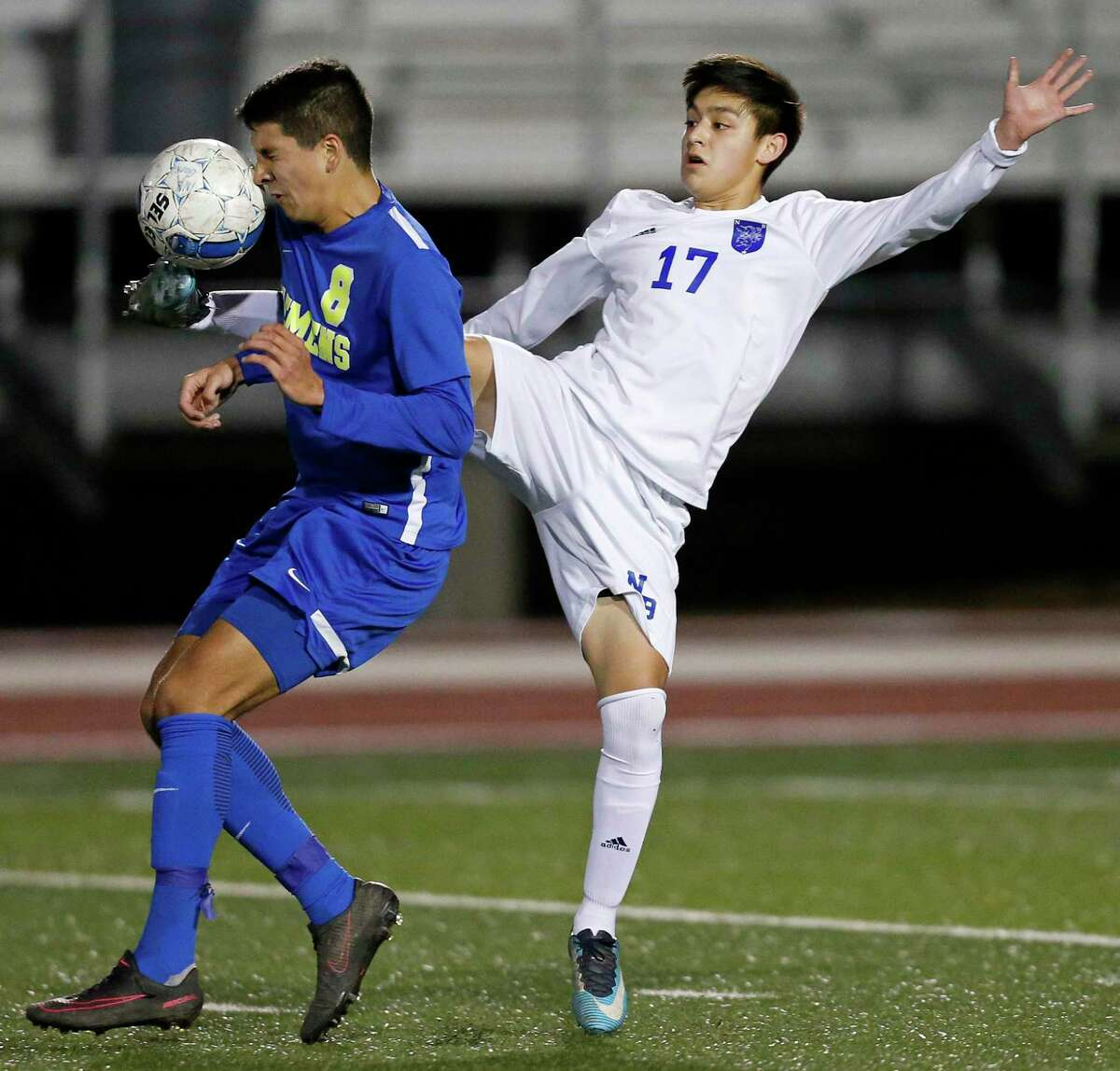 Clemens' Nicolas Mora (left) and New Braunfels' Dylan Navarijo go after the ball during first half action Friday Feb. 16, 2018 at Unicorn Stadium in New Braunfels, Texas.
