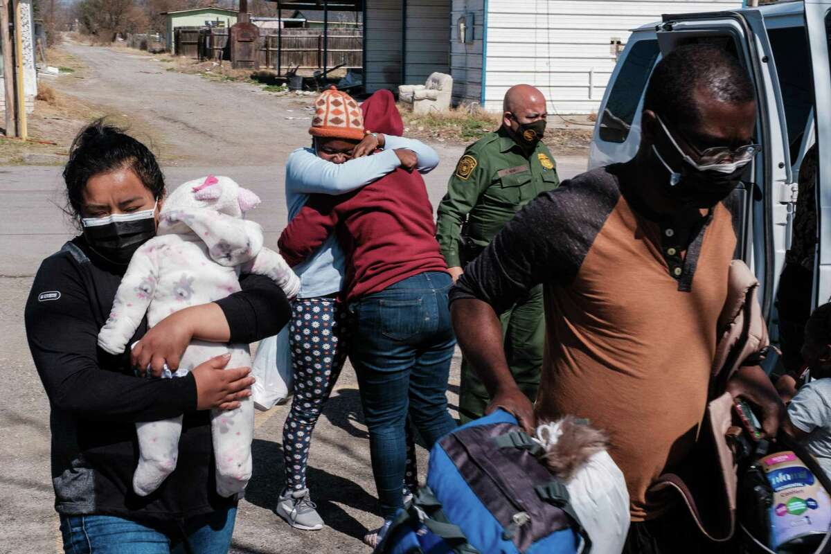 Migrants arrive at the Val Verde Humanitarian Border Coalition in February. As ICE releases more people from detention under the Biden administration, Texans can help immigrants weather their personal storms by offering shelter.