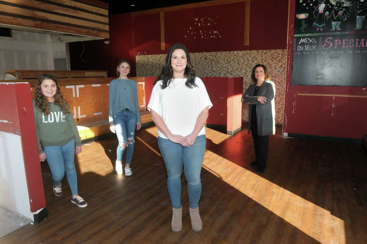 Melissa Cotto, owner, poses with some of her family in the restaurant space that will soon become Marianna's Pantry, in Trumbull, Conn. March 5, 2020. Cotto is seen here with her daughters, Liana and Alexandra, and her mother Marianna.