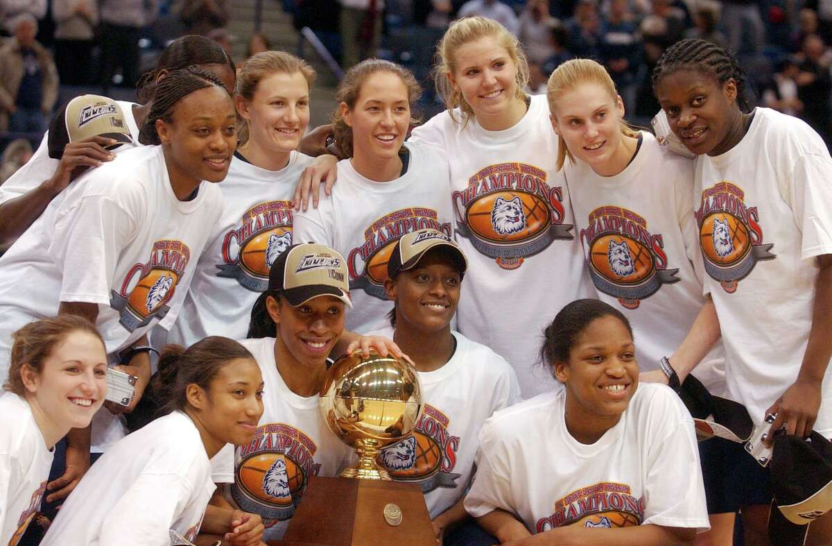 The UConn women's basketball team celebrate their win over Rutgers in the 2005 Big East Tournament Championship at the Hartford Civic Center.