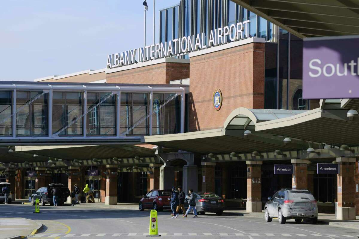 A view of the Albany International Airport on Monday, March 8, 2021, in Colonie, N.Y. The planned expansion of the second level of the terminal would bump out the area on both sides of the existing pedestrian walkway between the terminal and the parking garage, providing more space for expanded health and security screening. (Paul Buckowski/Times Union)