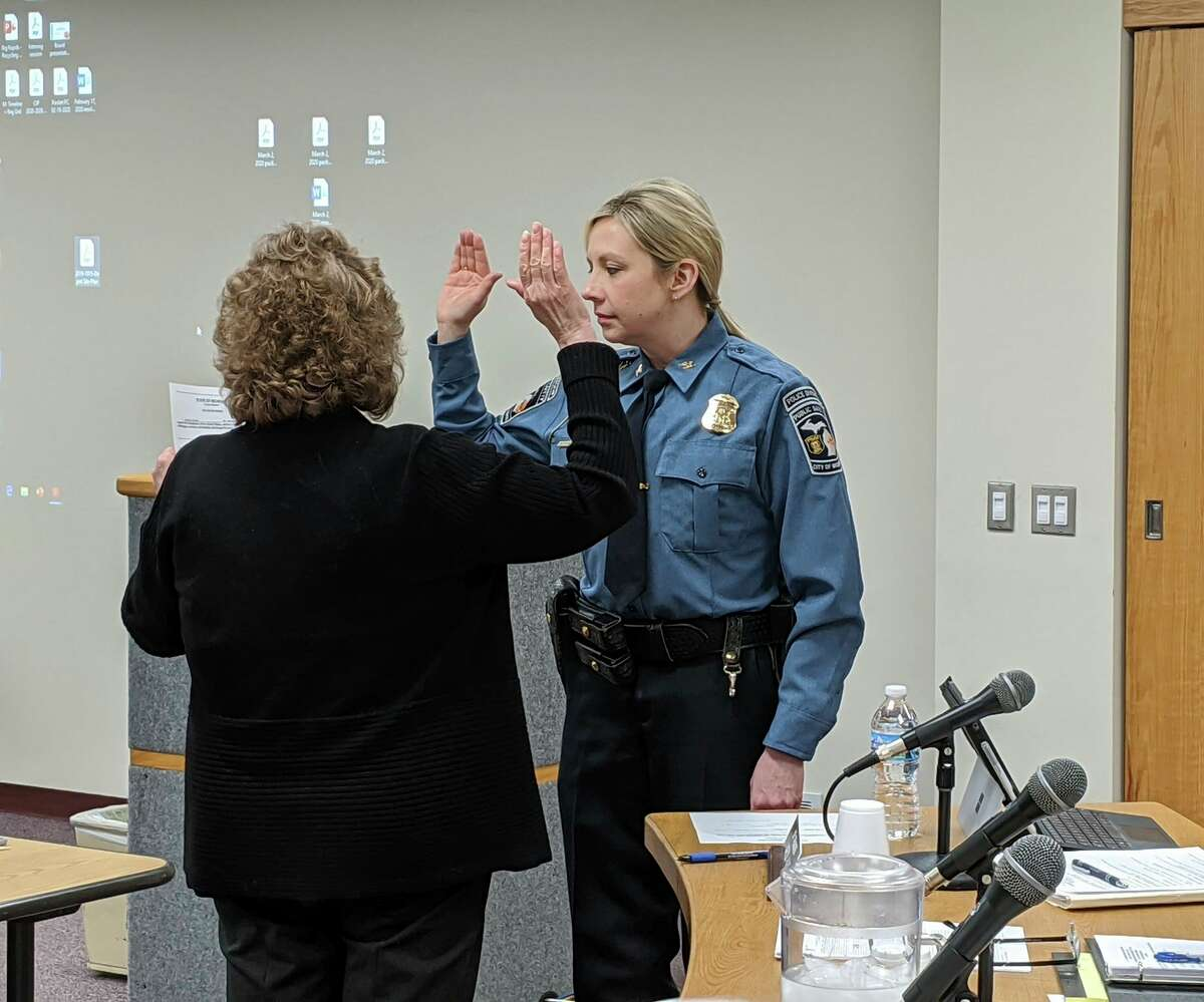 In this file photo, Danielle Haynes is pictured being sworn in as police chief of Big Rapids. She has been the Big Rapids Department of Public Safety chief of police for the past year. (Courtesy photo)