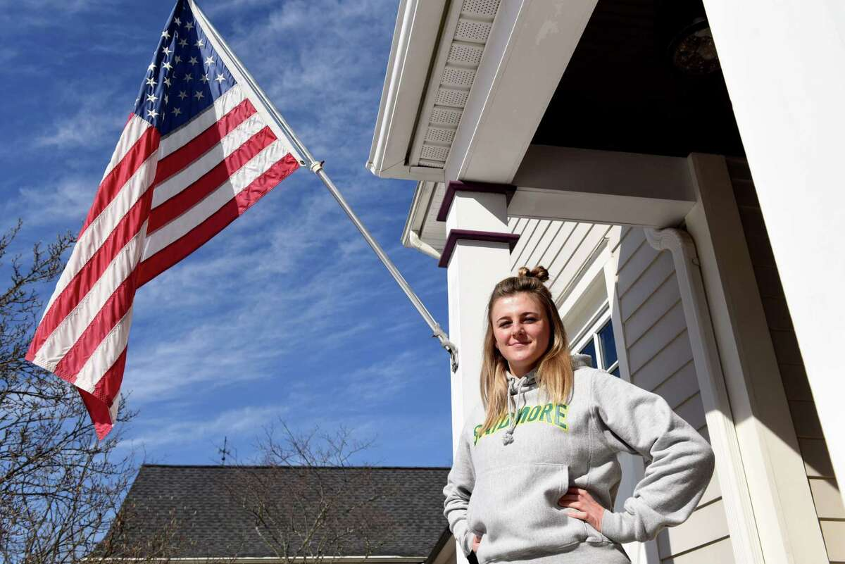Skidmore College junior Hannah Davis is pictured outside her apartment on Monday, March 8, 2021, in Saratoga Springs, N.Y. Davis tried to form a libertarian group, YAL or Young Americans for Liberty, at Skidmore. Her proposal was rejected by fellow students and the group was not allowed to form on campus. (Will Waldron/Times Union)