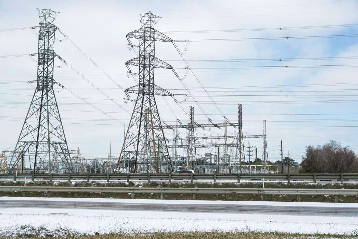 Power lines are shown near Beltway 8 the Hardy Toll Road following an overnight snowfall Monday, Feb. 15, 2021 in Houston.