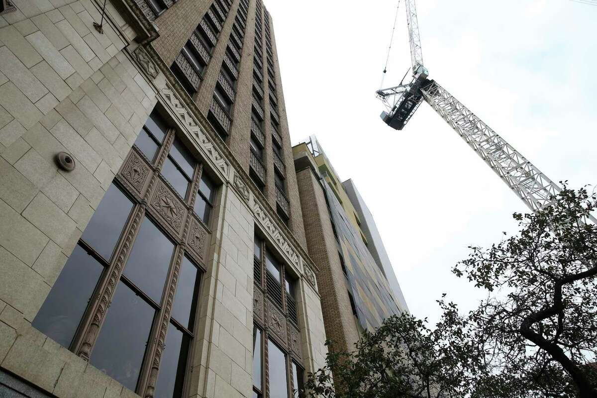 The tower crane was assisting in the construction of the Floodgate, a 16-story, 63-unit apartment complex that is expected to be completed in about a year.