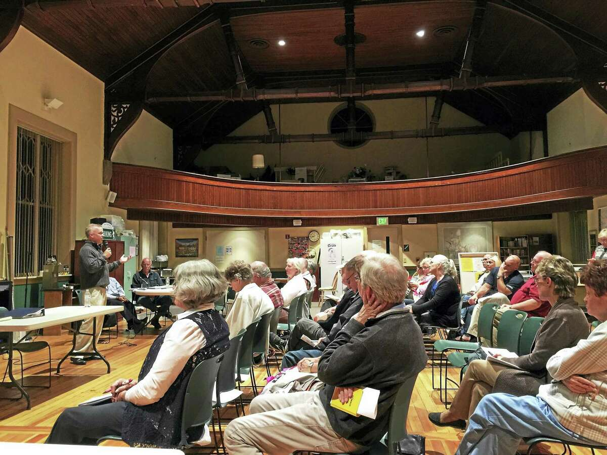 Voters approved the sale of the town's drinking water and sewer systems to Aquarion Water Company for $8 million, during a referendum March 6. Above, residents hear a presentation on the plan in 2017.
