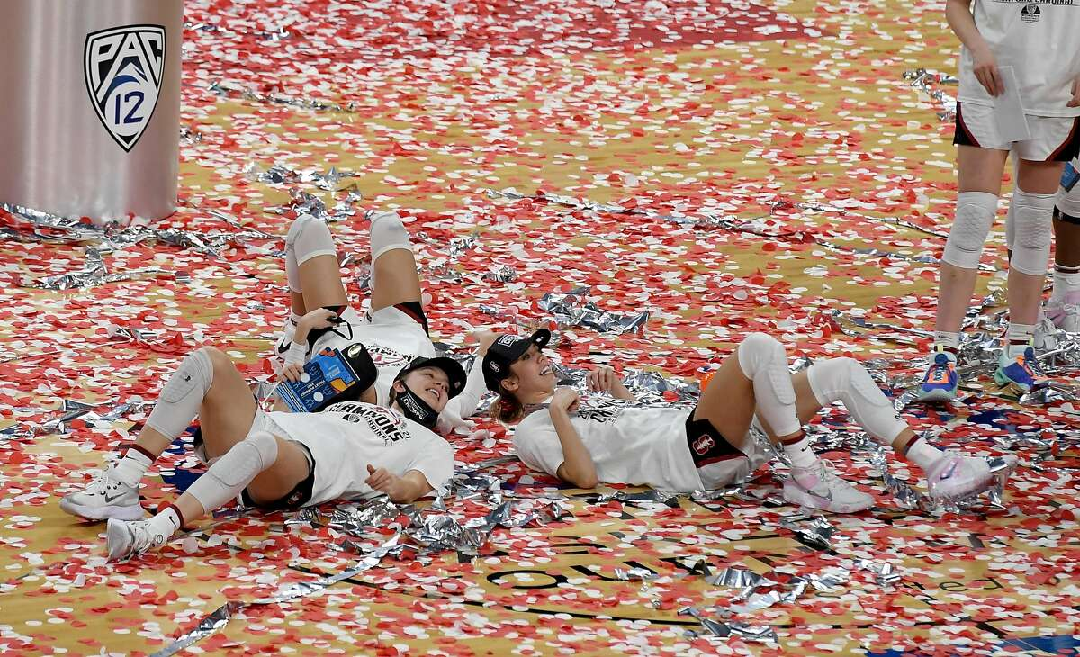 Stanford players bask in the confetti after the Cardinal beat UCLA 75-55 to win the the Pac-12 tourney title in Las Vegas.
