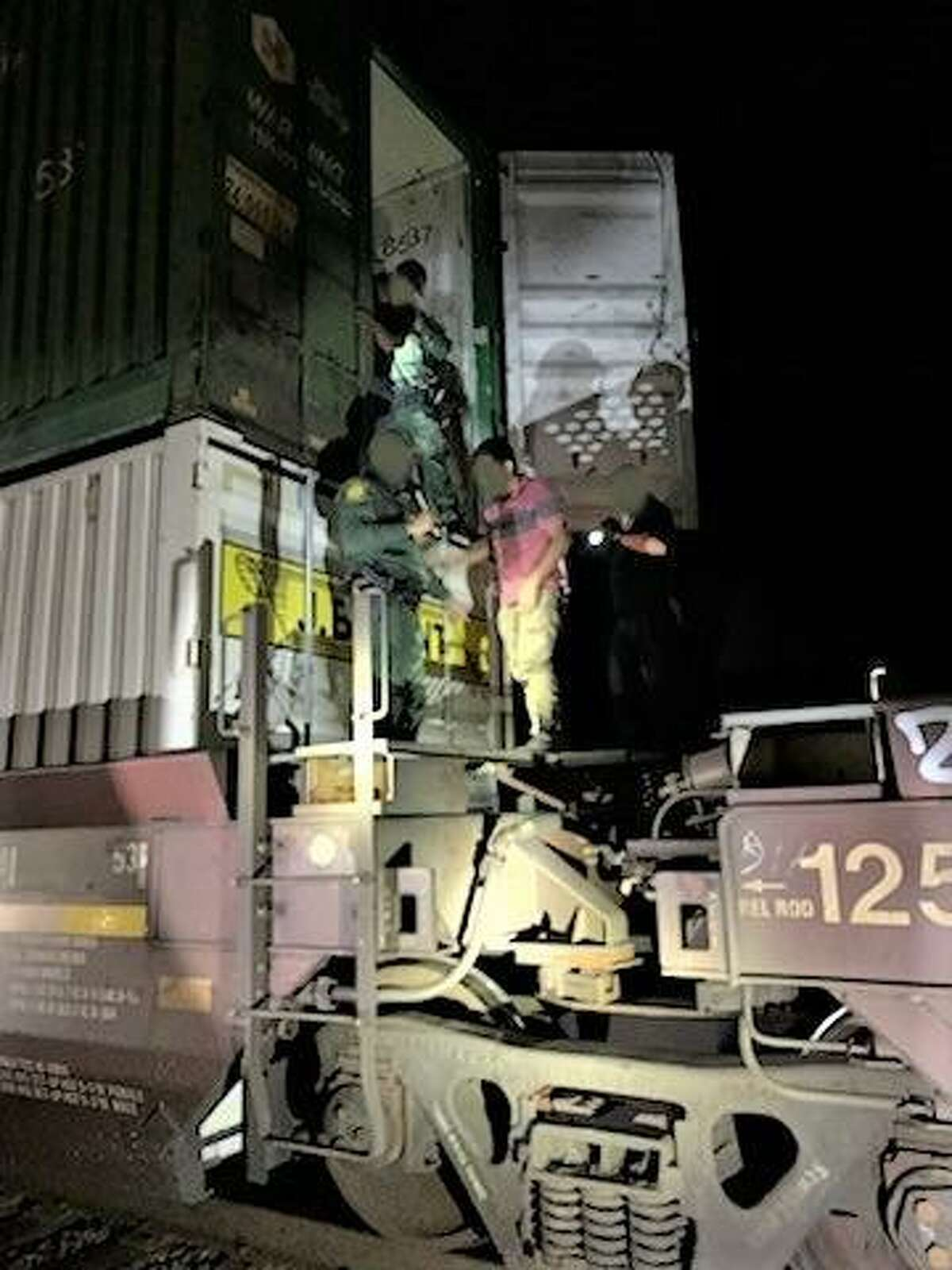 U.S. Border Patrol agents found 16 individuals inside a storage container while inspecting a train near Hebbronville. All were determined to be immigrants who were in the country illegally.
