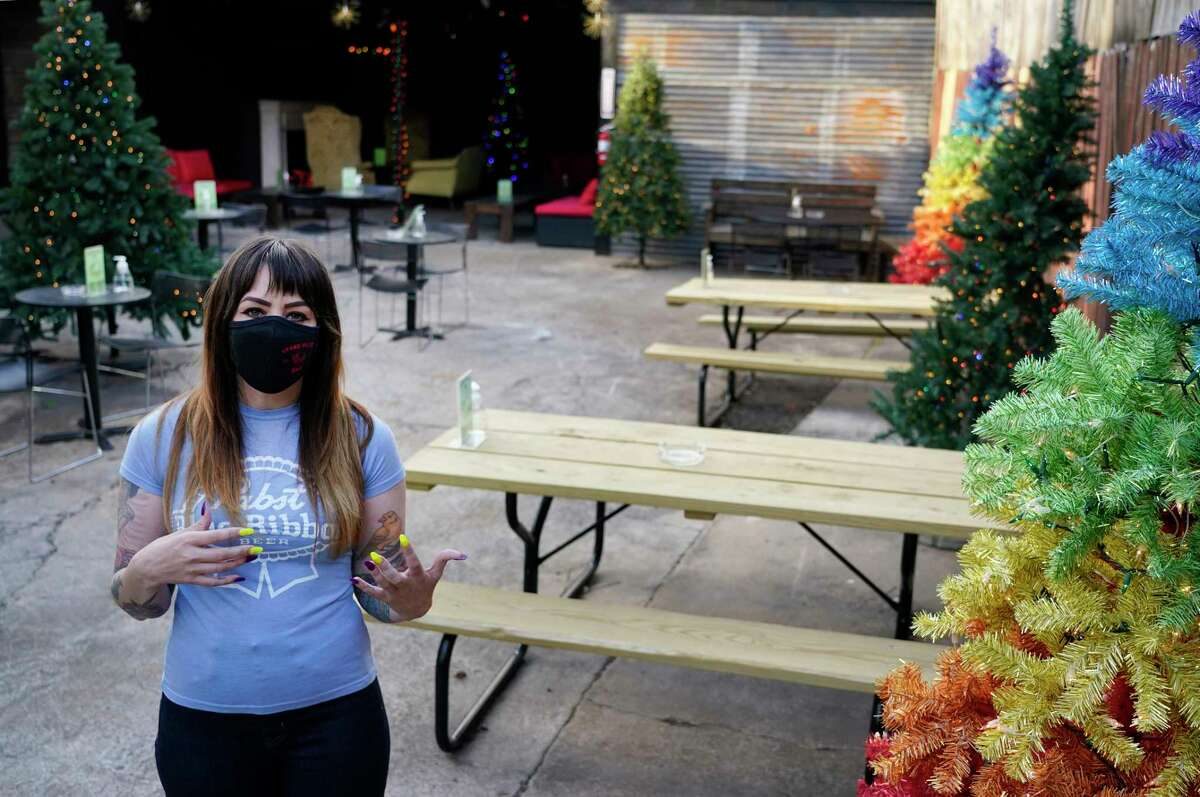 Lindsay Beale, general manager, talks about the outdoor space they converted from the parking lot at Grand Prize Bar, 1010 Banks St., Monday, March 8, 2021 in Houston. They decided to keep up their Christmas decorations. Small and medium-sized business owners in Houston said they strongly support vaccinations to protect against COVID-19 and plan to encourage their employees to get the shots, according to a survey of small business owners. Grand Prize Bar is one of the businesses that will be encouraging its staff to get vaccinated.