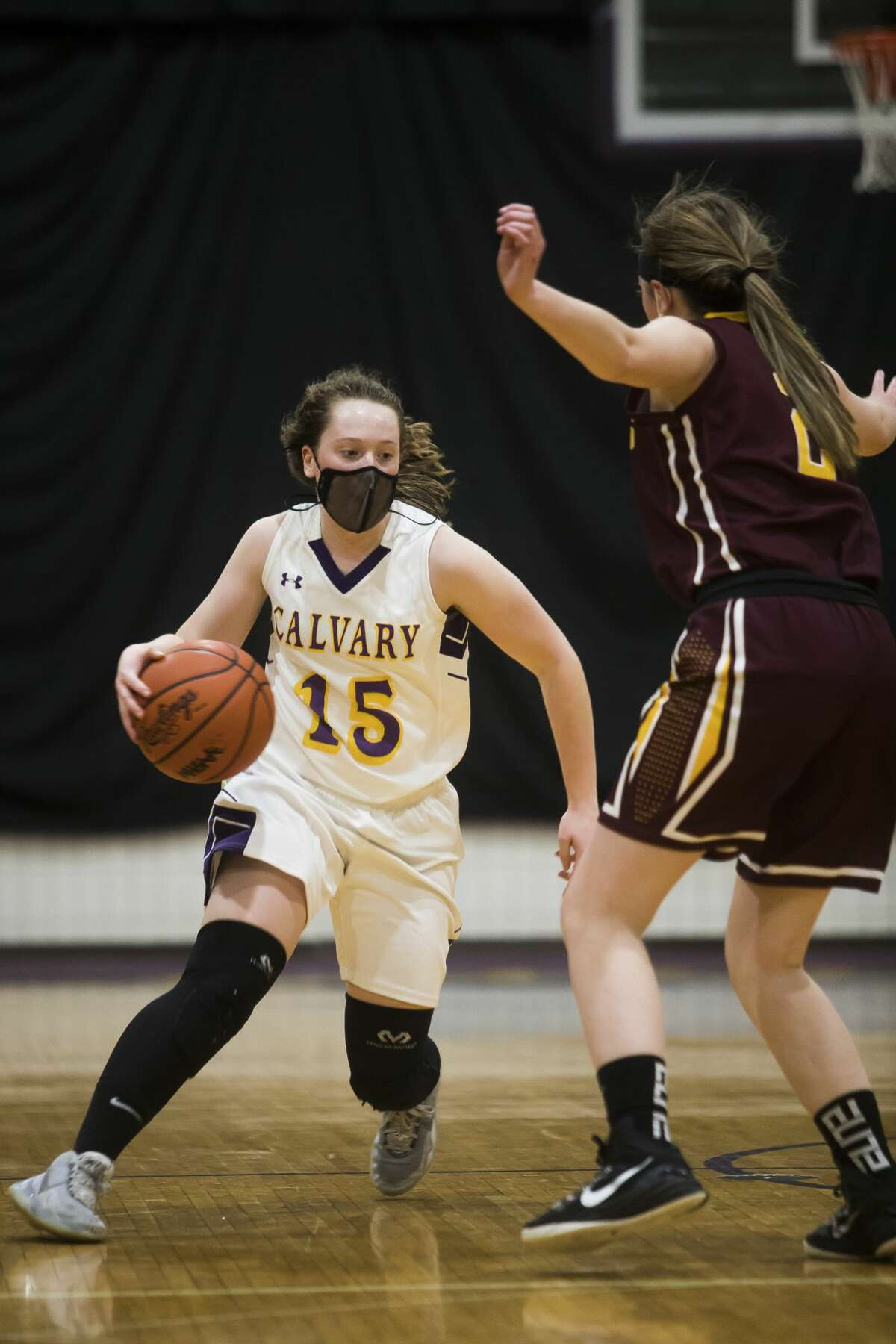 Calvary Baptist's Caitlyn Dickerson dribbles down the court during a game against Au Gres-Sims Monday, March 8, 2021 at Calvary Baptist Academy. (Katy Kildee/kkildee@mdn.net)