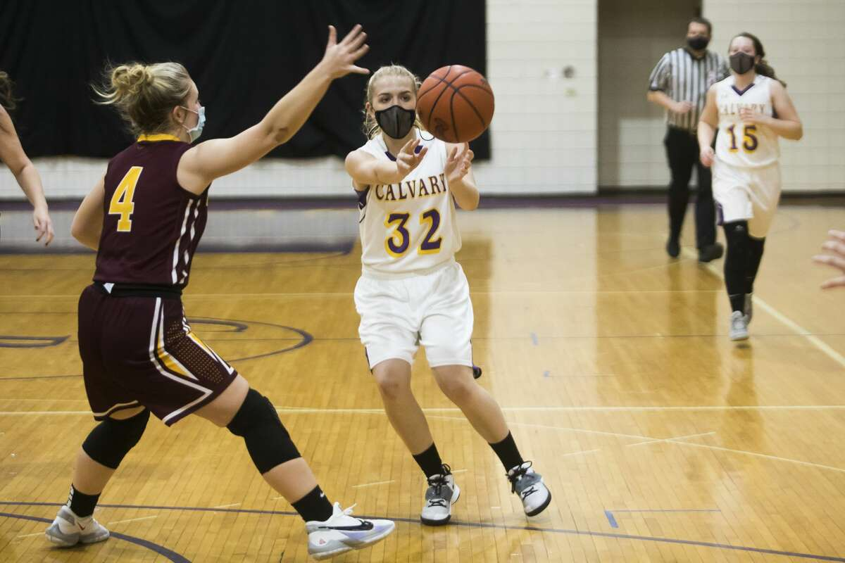 Calvary Baptist's Emma Schmidt passes to a teammate during a game against Au Gres-Sims Monday, March 8, 2021 at Calvary Baptist Academy. (Katy Kildee/kkildee@mdn.net)
