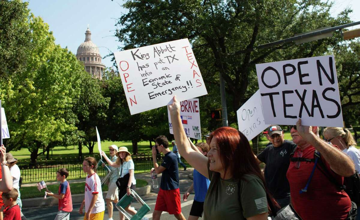 Protesters took to the street to march around the Governors Mansion over their disagreement with Gov. Greg Abbott handling of Covid-19 with mask mandates and business closures and restrictions at the Governor's Mansion on October 10, 2020 in Austin, Texas.