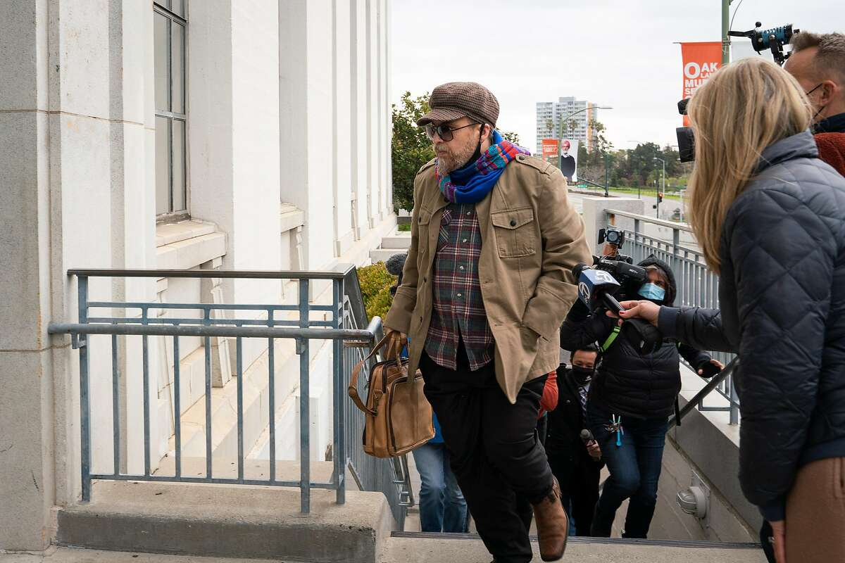 Derick Almena, defendant in deadly Ghost Ship fire, bolts past members of the press while entering his sentence hearing at Rene C. Davidson Courthouse in Oakland, Calif., on Monday, March 8, 2021. During his sentencing, Judge Trina Thompson ruled Almena will spend the rest of his 12 year sentence from home.