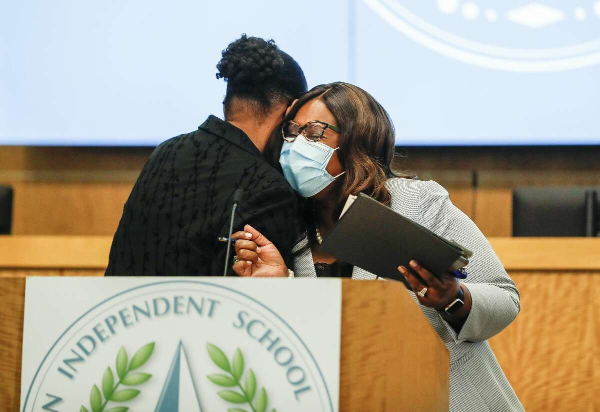 Houston Independent School District Interim Superintendent Dr. Grenita Lathan gets a hug from HISD Board of Education president Patricia Allen after her press conference to announce her decision to leave HISD to become the next Superintendent of Springfield, Missouri's public schools, in the Board Auditorium at the Hattie Mae White Educational Support Center, 4400 West 18th Street, Monday, March 8, 2021, in Houston.