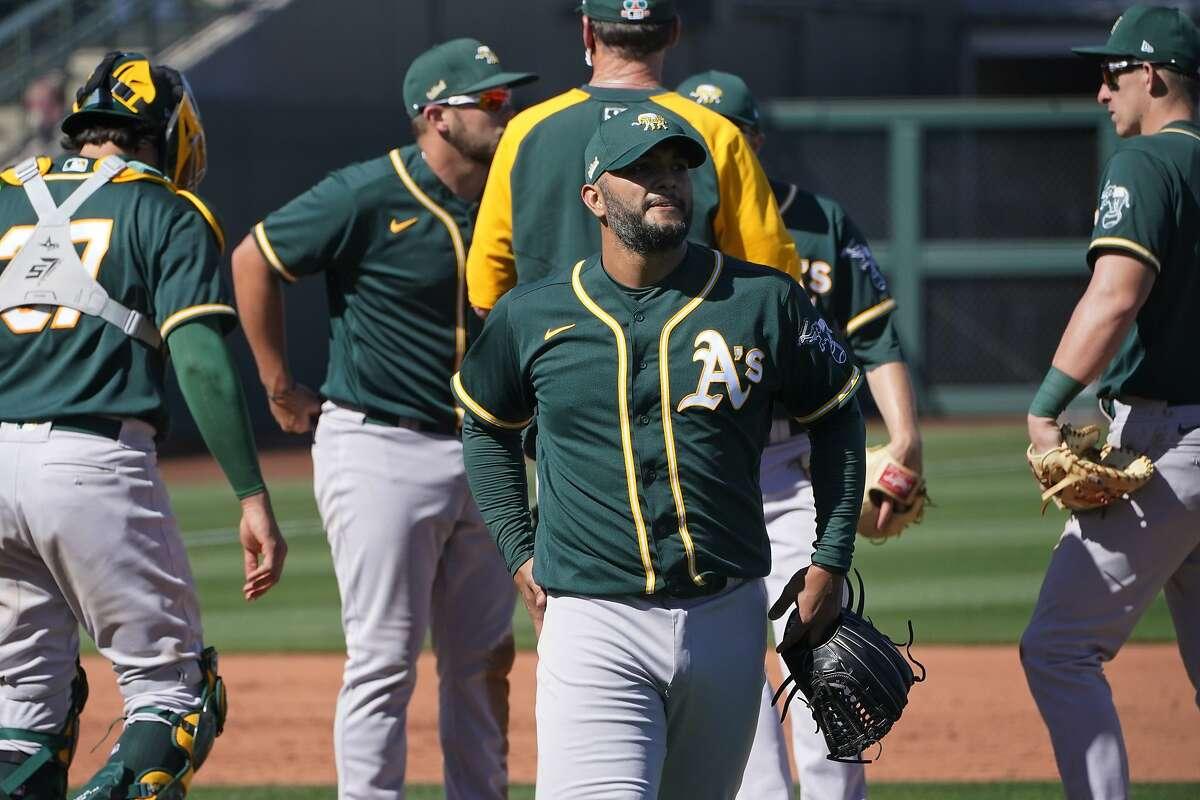 Oakland Athletics pitcher Yusmeiro Petit leaves the game in the fourth inning of a spring training baseball game against the Kansas City Royals, Monday, March 8, 2021, in Surprise, Ariz. (AP Photo/Sue Ogrocki)