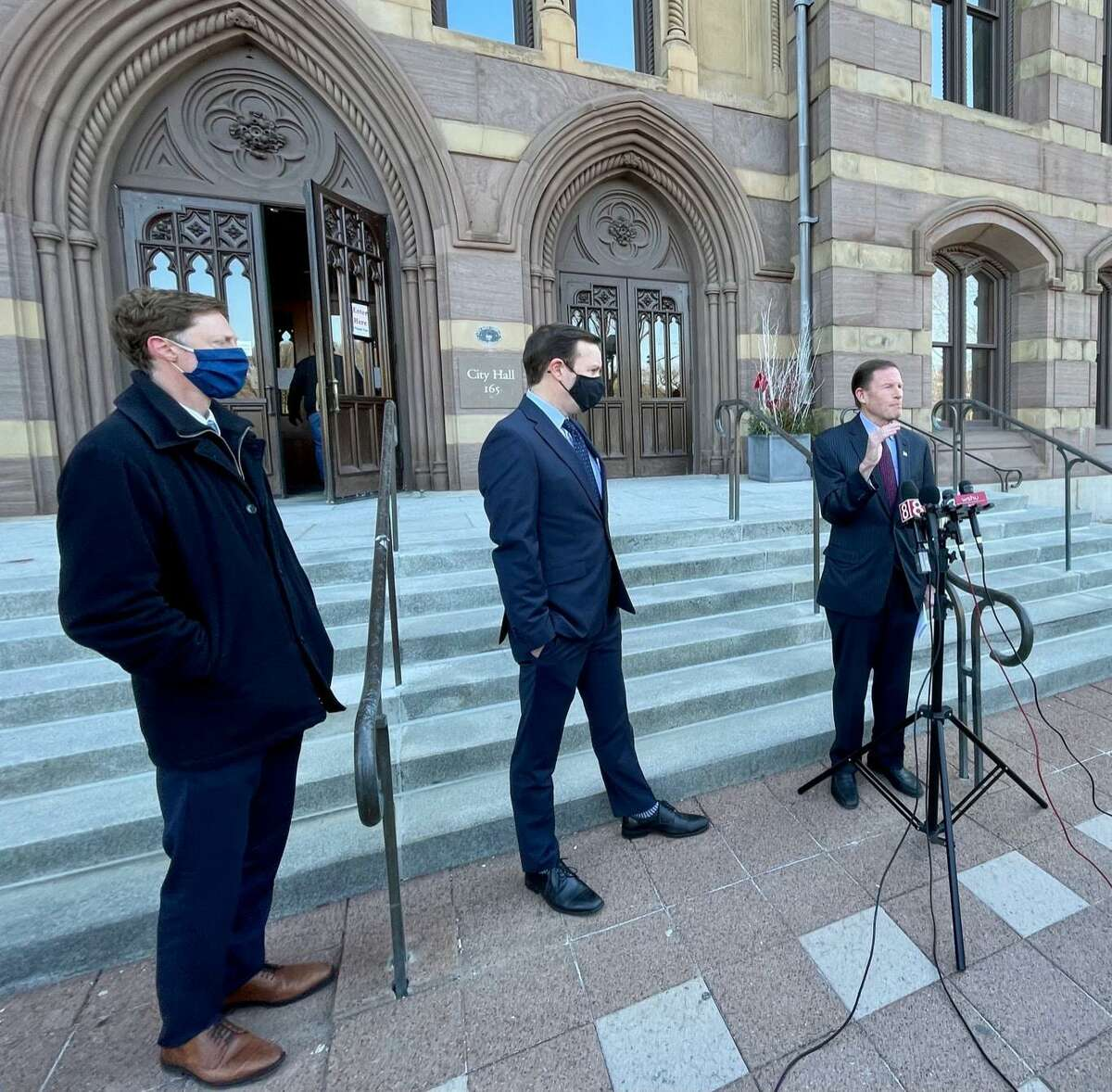 New Haven Mayor Justin Elicker and Sens. Chris Murphy, center, and Richard Blumenthal hailed the $1.9 trillion American Rescue Plan Monday. The bill, combined with a smaller stimulus adopted in December, will send $5.8 billion to city, town and state coffers in Connecticut.