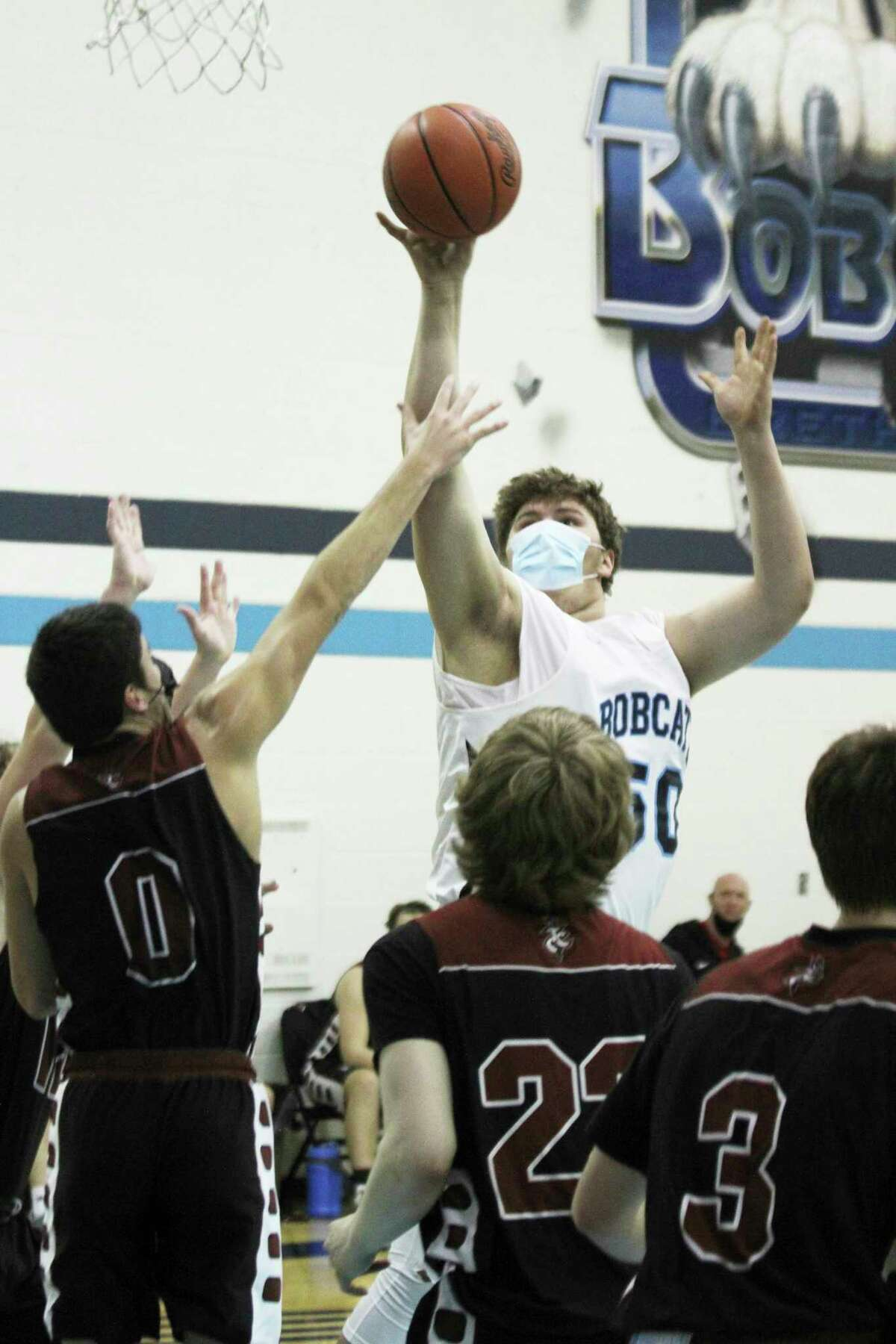 Brethren's Anthony Beccaria eyes the hoop during Monday's win over Traverse City Christian. (Dylan Savela/News Advocate)