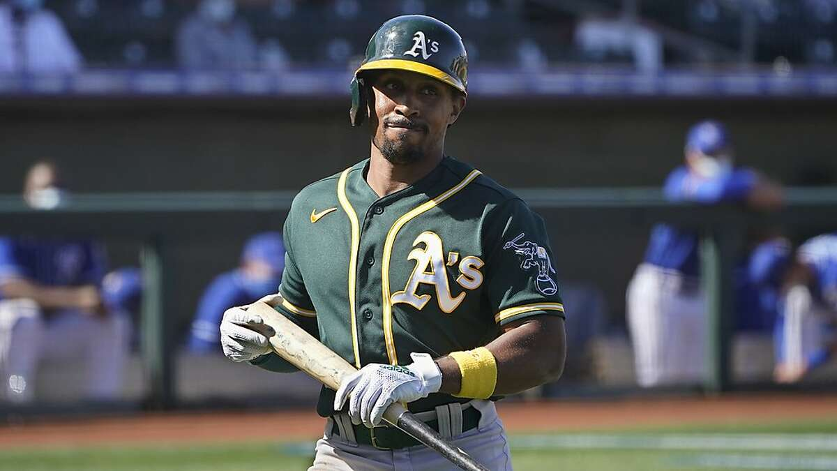 Oakland Athletics's Tony Kemp walks to the dugout after a strike out in a spring training baseball game against the Kansas City Royals, Monday, March 8, 2021, in Surprise, Ariz. (AP Photo/Sue Ogrocki)