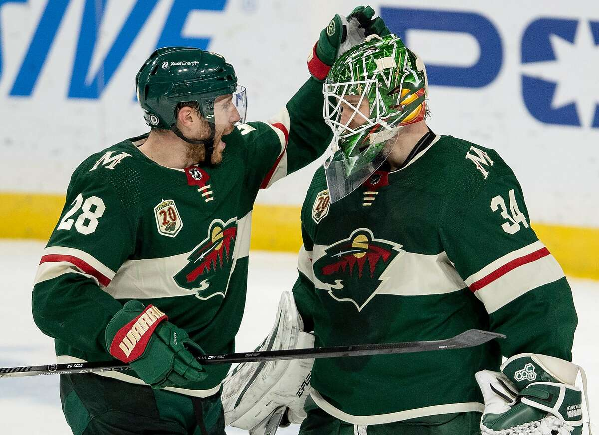 Ian Cole (28) of the Minnesota Wild celebrates with goalie Kaapo Kahkonen (34) at the end of the game on March 8, 2021 between the Wild and the Las Vegas Golden Knights at Xcel Energy Center in St. Paul, Minnesota. (Carlos Gonzalez/Minneapolis Star Tribune/TNS)