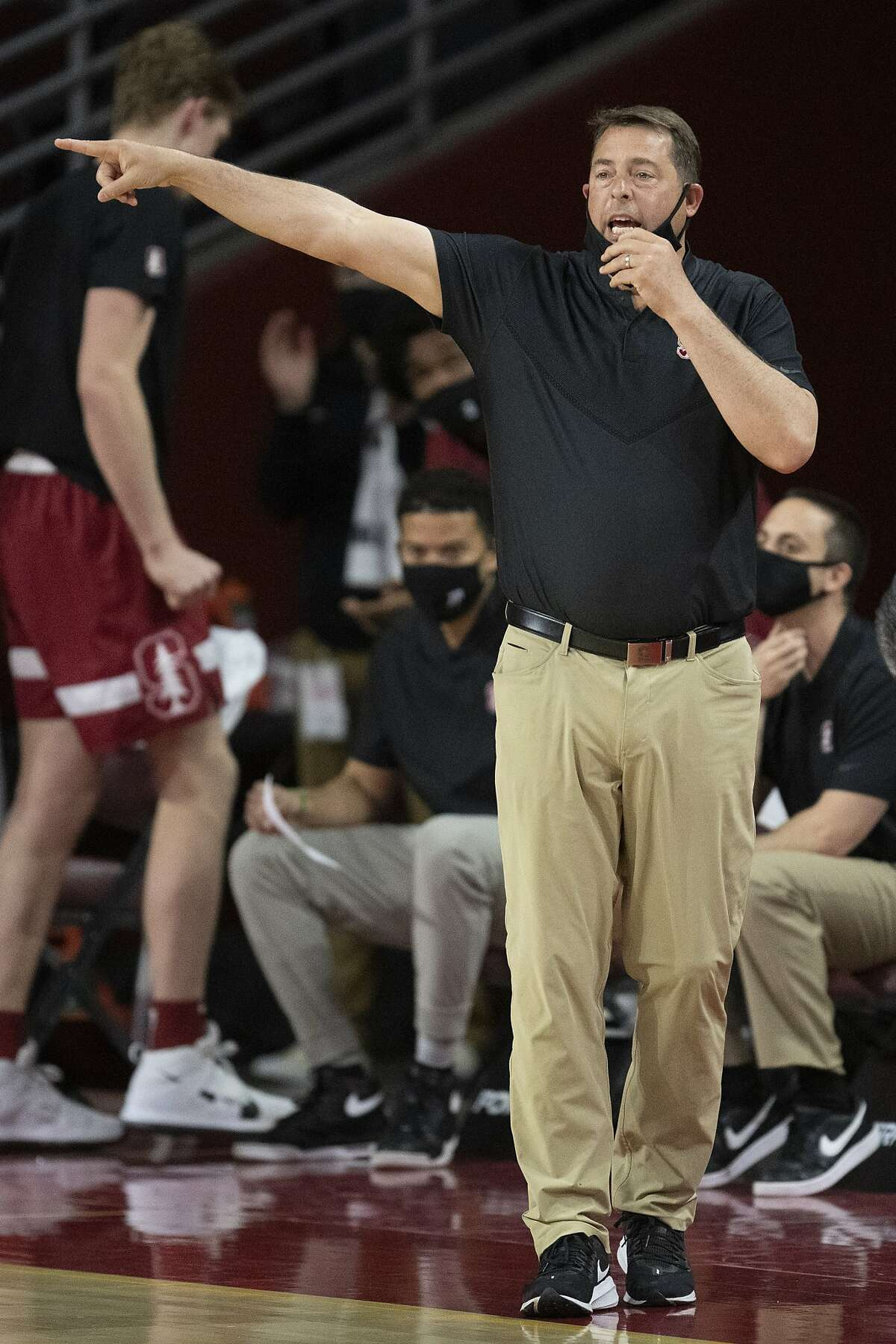 Stanford coach Jerod Haase gives instructions to players during the first half of the team's NCAA college basketball game against Southern California on Wednesday, March 3, 2021, in Los Angeles. (AP Photo/Kyusung Gong)