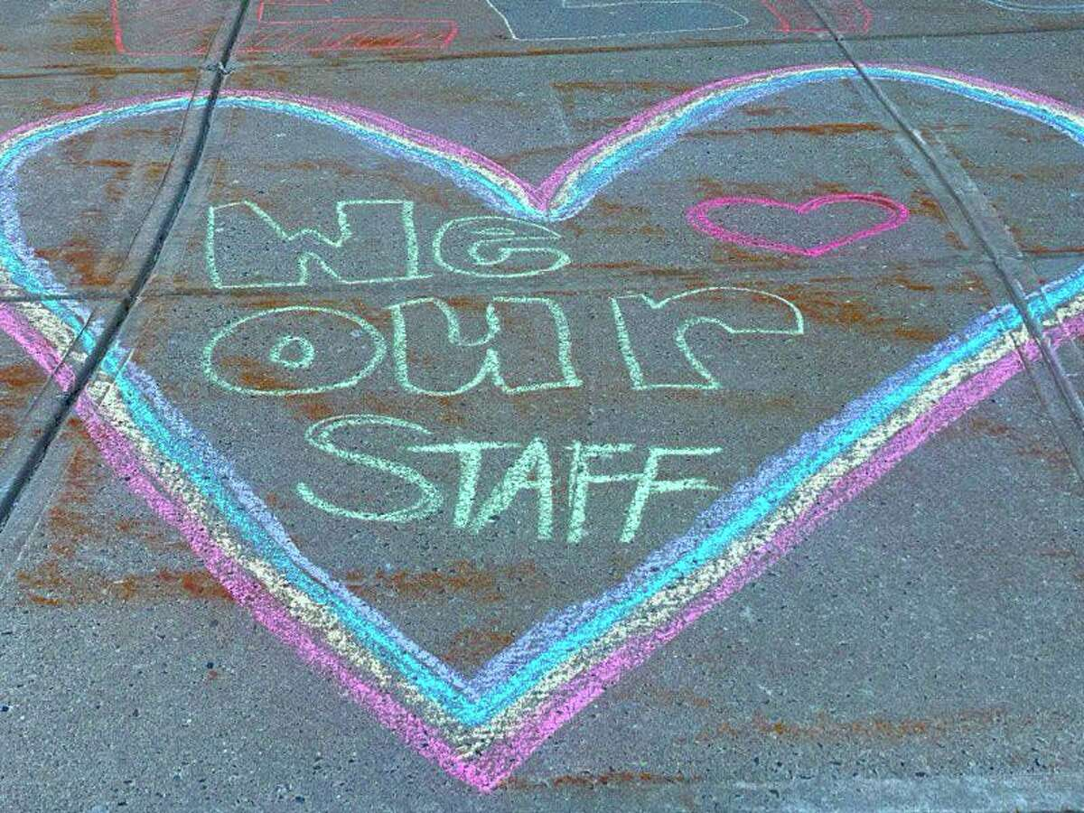 Shelton school staffers were greeted at the March 6 COVID vaccine clinic at Shelton Intermediate School with welcoming chalk drawings.