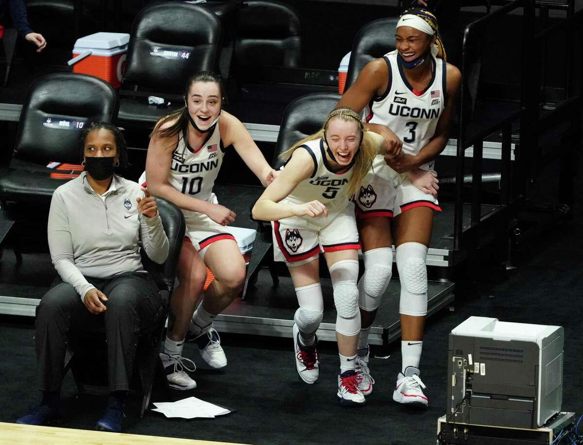 Mar 8, 2021; Uncasville, Connecticut, USA; UConn Huskies guard Nika Muhl (10), guard Paige Bueckers (5) and forward Aaliyah Edwards (3) react after a play on the court against the Marquette Golden Eagles in the second half at Mohegan Sun. Mandatory Credit: David Butler II-USA TODAY Sports