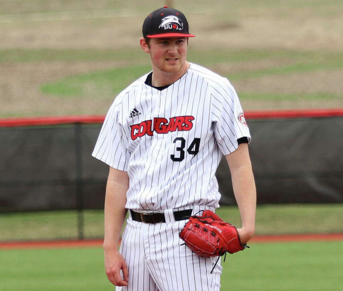 SIUE pitcher Collin Baumgarter peers in for a sign during a start in 2019. Baumgartner underwent elbow surgery last week and will miss the 2021 season.