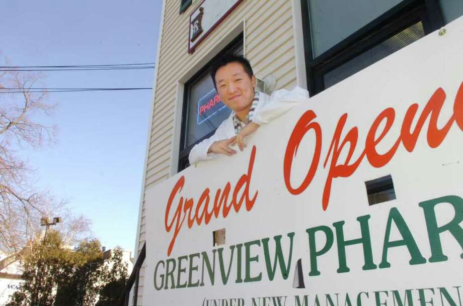 Scott Wong, the manager of the Greenview Pharmacy, formerly the Byram Pharmacy, is seen in this December 2008 file photo. Police are searching for a man who robbed the Greenview Pharmacy in Byram on Saturday using a large knife. Photo: File Photo / Greenwich Time File Photo