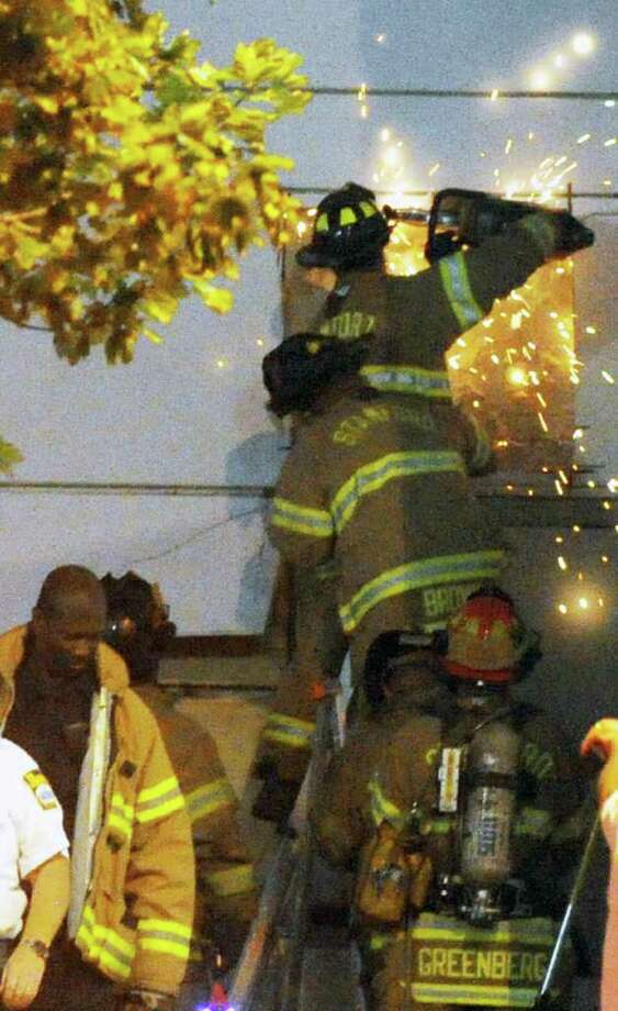 Stamford Fire and Rescue responds to a fire at UCONN cutting into the side of the building on the Washington Boulevard side of the campus  Wednesday, September 8, 2001. The cause of the fire is under investigation. Photo: Keelin Daly / Stamford Advocate