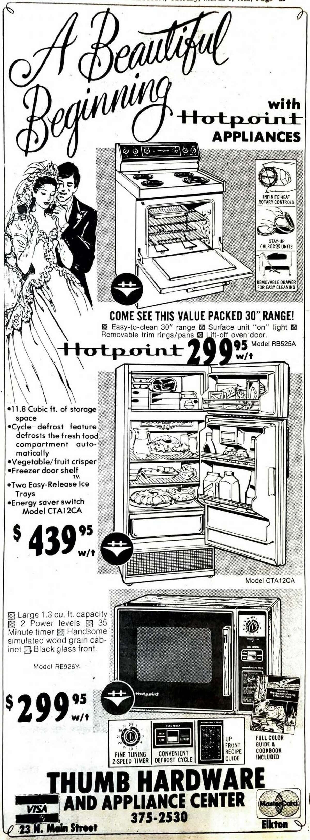 An ad featured in the bridal section - nothing spells marital bliss like a $300 microwave the size of a small Volkswagen.