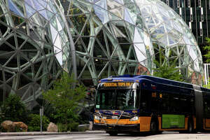 SEATTLE, WA - APRIL 30: A King County Metro bus for essential trips only passes by The Spheres at the Amazon campus on April 30, 2020 in Seattle, Washington. Amazon recorded sales of $75.4 billion in the first three months of the year as many consumers increased their online purchases, up 26% over last year, but with net income for the same period falling nearly 31% due to costs of managing the coronavirus pandemic. (Photo by Lindsey Wasson/Getty Images)