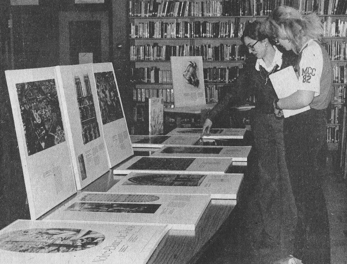 The above photo was published in the News Advocate onMarch 10, 1981. (From left) Maria Herrmann, librarian at Manistee Catholic Central, explains part of the Notre Dame de Paris exhibit to junior student Laura Fumerola. The fine exhibit is sponsored by the Detroit Institute of Arts and will be on display in the Manistee Catholic Central Library. (Manistee County Historical Museum photo)