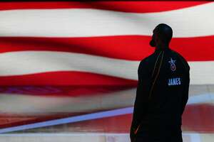LeBron James #23 of Team LeBron stands for the national anthem prior to the 70th NBA All-Star Game at State Farm Arena on March 7, 2021 in Atlanta, Georgia.