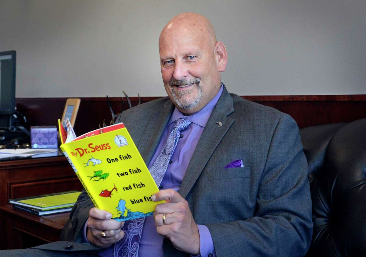"""State Sen. Curt VanderWall, R-Ludington, reads one of his favorite children's classics, """"One Fish, Two Fish, Red Fish, Blue Fish,"""" by Dr. Seuss. (Courtesy photo)"""
