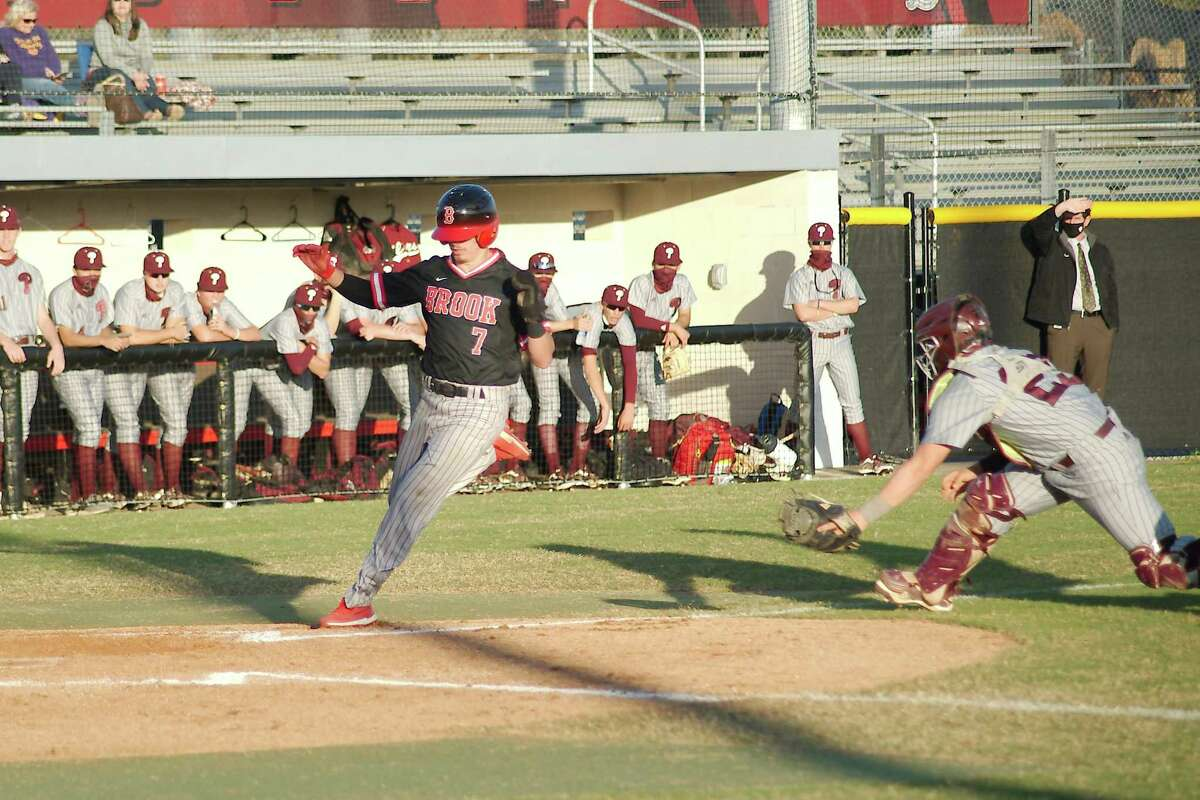 Clear Brook's Landon Hunt, shown scoring against Pearland, drove in one Wolverine run Tuesday night in a 2-0 Brook victory over Brazoswood which kept the Wolverines atop the District 24-6A standings.
