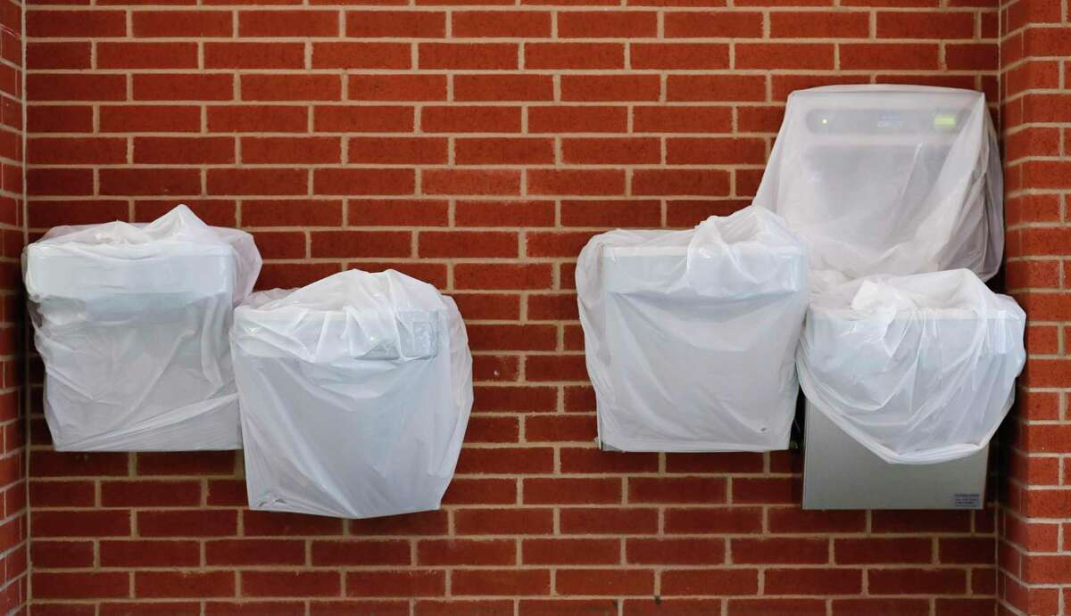 Water fountains are covered up at Splendora High School Aug. 11 in Splendora. The Splendora ISD board voted unanimously Monday to continue with health and safety protocols, including masks.