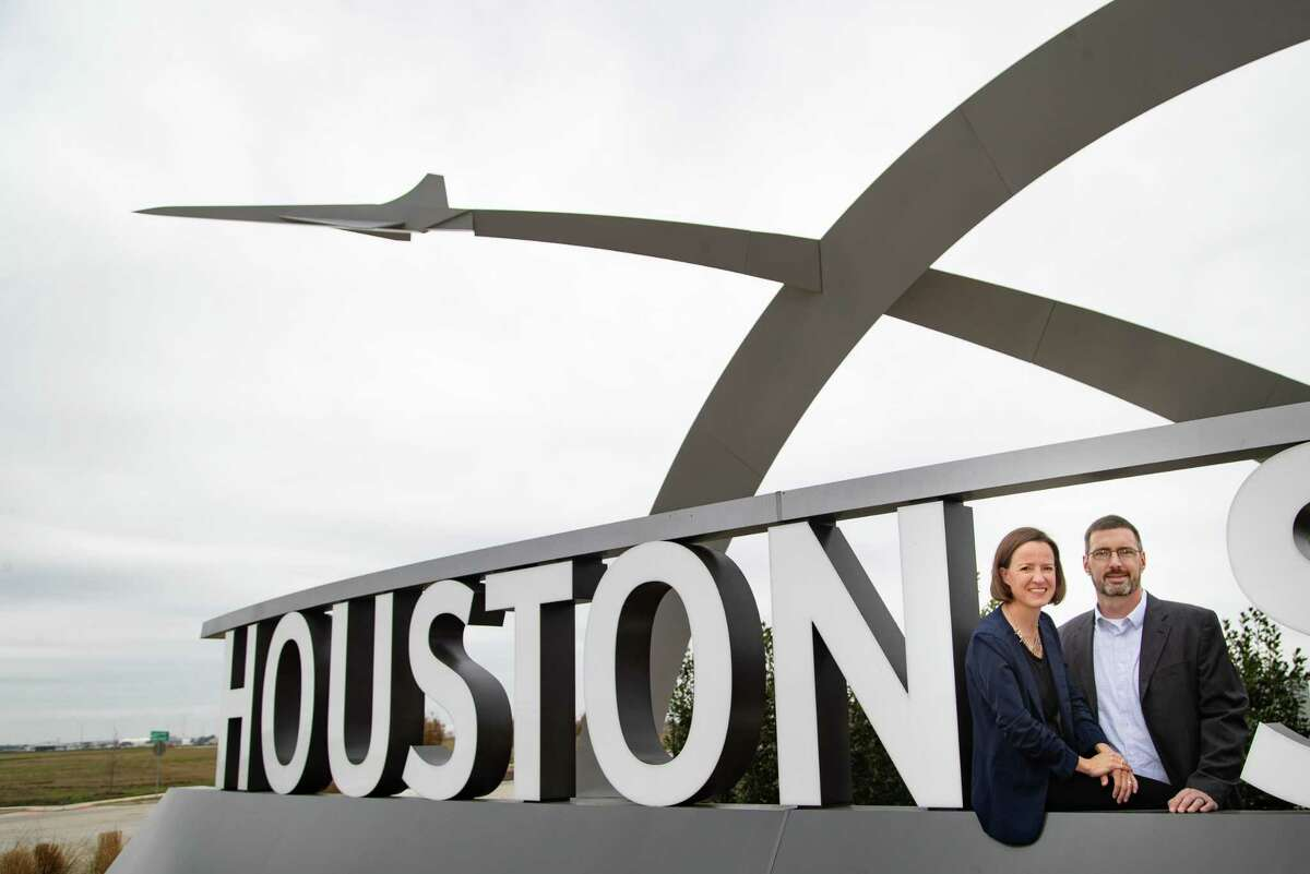 """Sarah """"Sassie"""" Duggleby, Venus Aerospace co-founder and CEO, and her husband Andrew Duggleby, Venus Aerospace co-founder and Chief Technology Officer at the Houston Spaceport entrance sign, Friday, March 5, 2021, in Houston."""