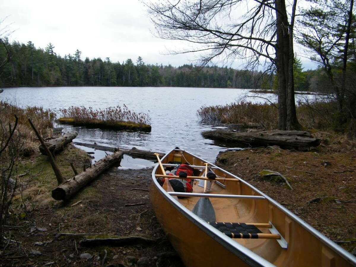 A canoe rests on the shore of Little Pond, which is a portion of the seven carries in the St. Regis Canoe Area. The route is best done over three days, but can be done in as little as one, according to St. Regis Canoe Outfitters.