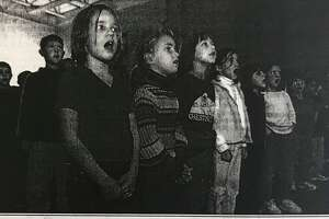 """From left, Chestnut Hill students Gabby Axtell, Gretchen Holzhauer, Amy Felzke and Bianca Cuccioli, join more than 250,000 school children throughout the United States at 1:30 p.m. Thursday, Nov. 8, 2001, singing """"God Bless America."""""""