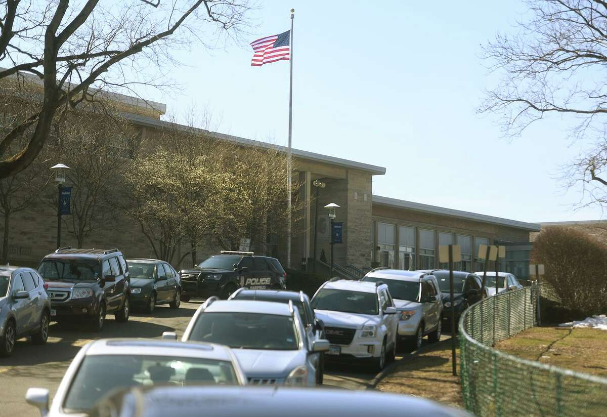 Students return to full classrooms for the first time in a year at Ludlowe High School in Fairfield, Conn. on Tuesday, March 9, 2021.