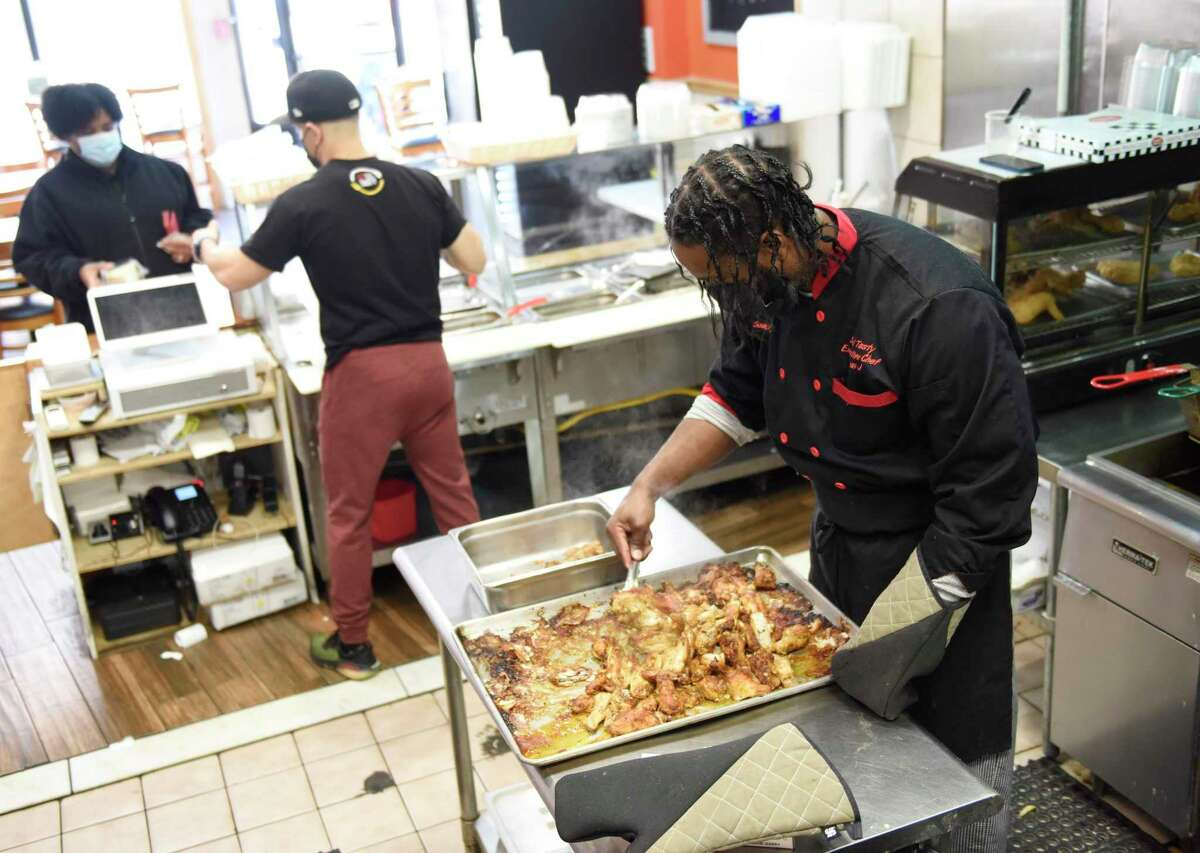 Soul Tasty co-owner Jean Gabriel in late February 2021 at his Stamford, Conn. restaurant. More than 28,500 Connecticut workers in the food and accommodations industry were seeking jobs, according to the state Department of Labor.