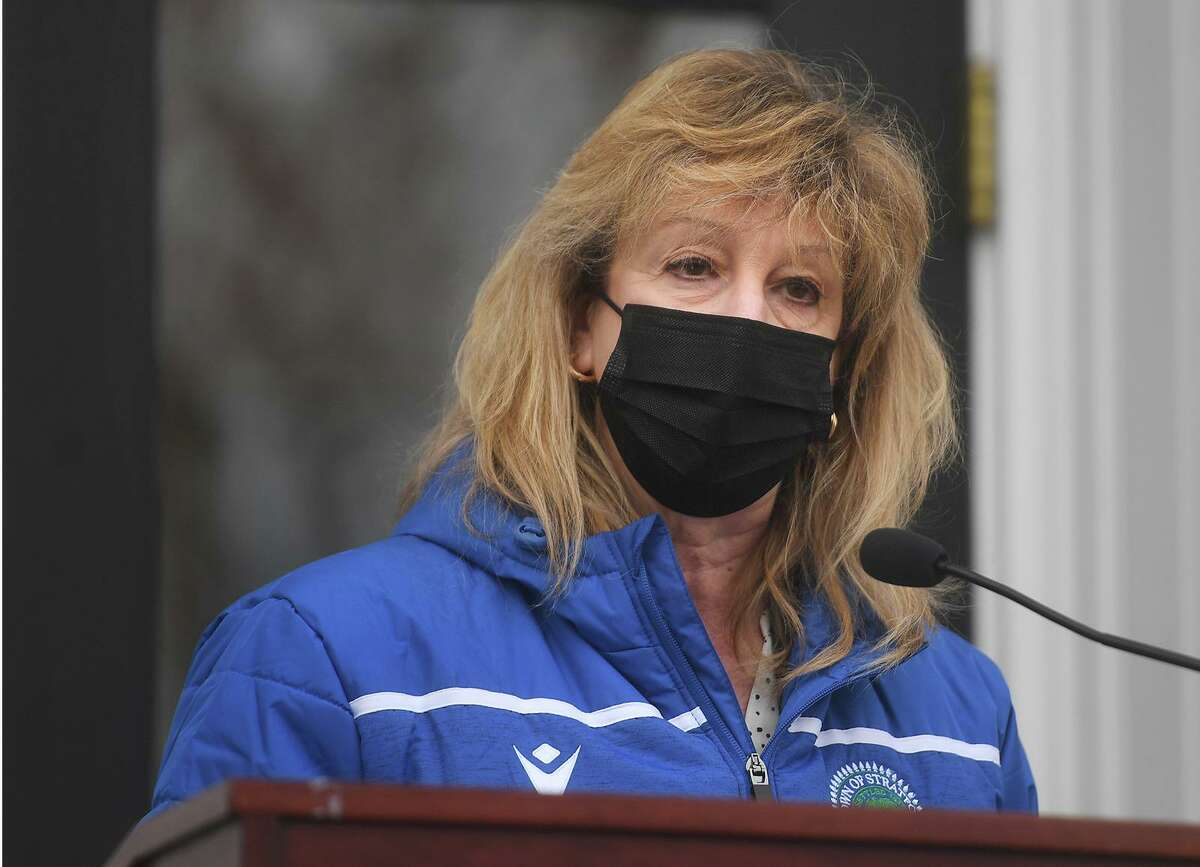 Stratford Mayor Laura Hoydick leads a remembrance vigil for COVID-19 victims and survivors on the one year anniversary of the first U.S. death from the virus outside Town Hall in Stratford, Conn. on Monday, March 1, 2021.