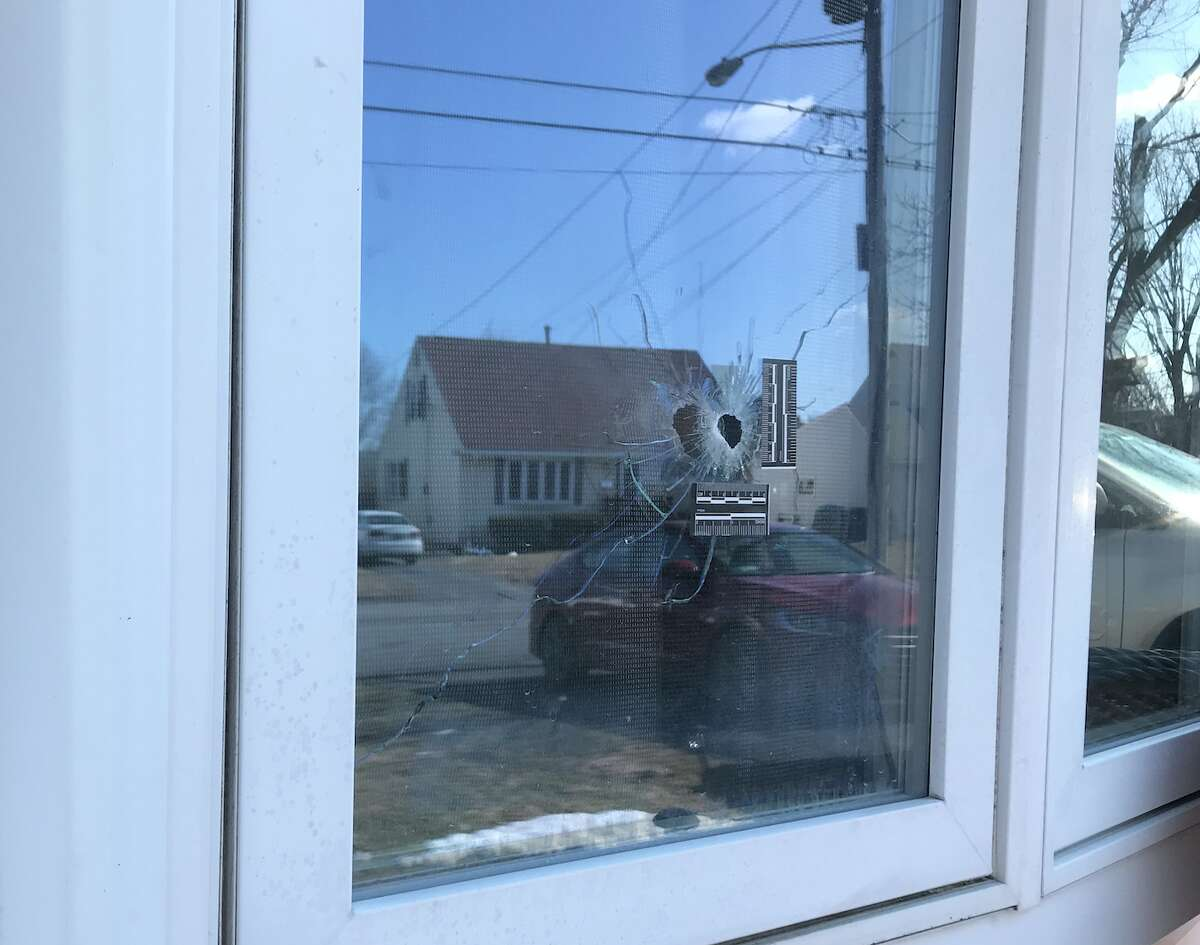 The window near the living room that was pierced by a bullet on O'Neil Street in Troy. A 12-year-old was paralyzed in the shooting, and two people Sept. 14, 2021 were arraigned on attempted murder charges in the incident.