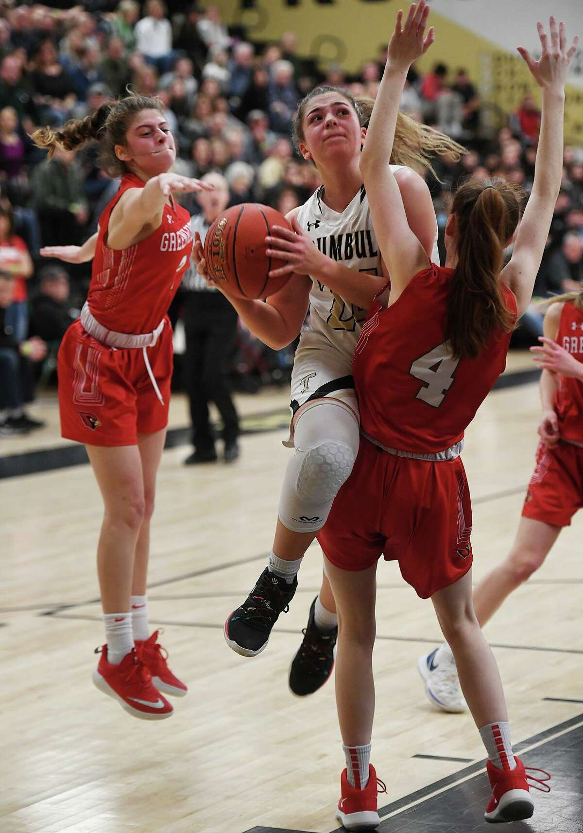 Trumbull's Cassi Barbato drives to the basket against Greenwich defender Ciara Munnelly during the first half of their CIAC Class LL girls basketball quarterfinal game at Trumbull High School in Trumbull, Conn. on Monday, March 9, 2020.