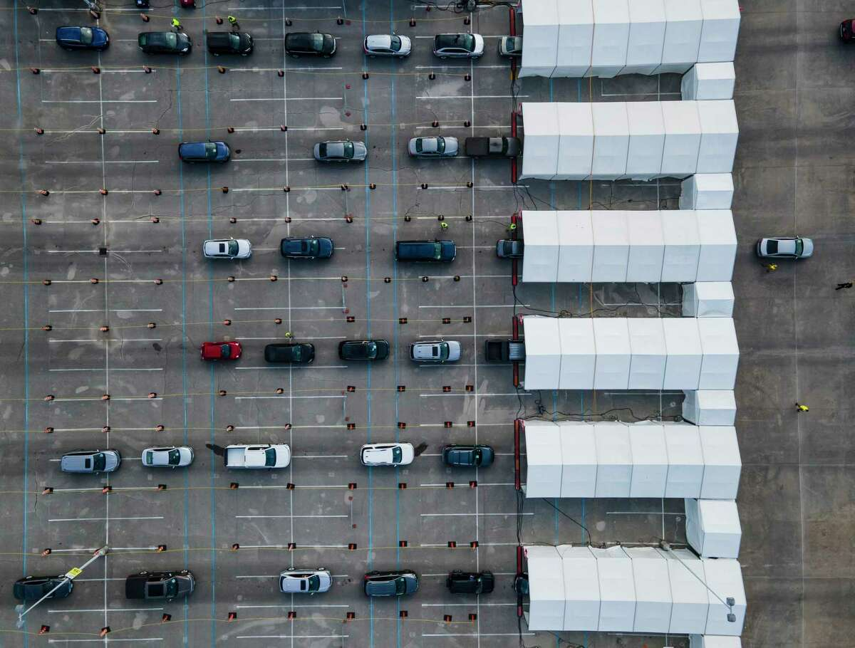People wait in line in their cars to receive the vaccine to prevent COVID-19 at the FEMA-run mass vaccination site at NRG Park on Monday, March 8, 2021, in Houston.