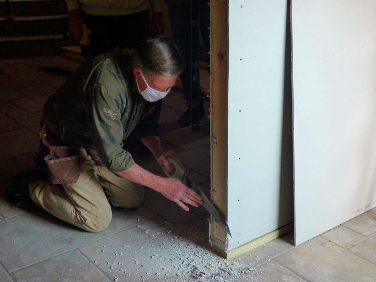 VolunteerBruce Fredrickson works on the entrance to a new meditation and prayer room at the Wagoner Community Center in Manistee. (Scott Fraley/News Advocate)