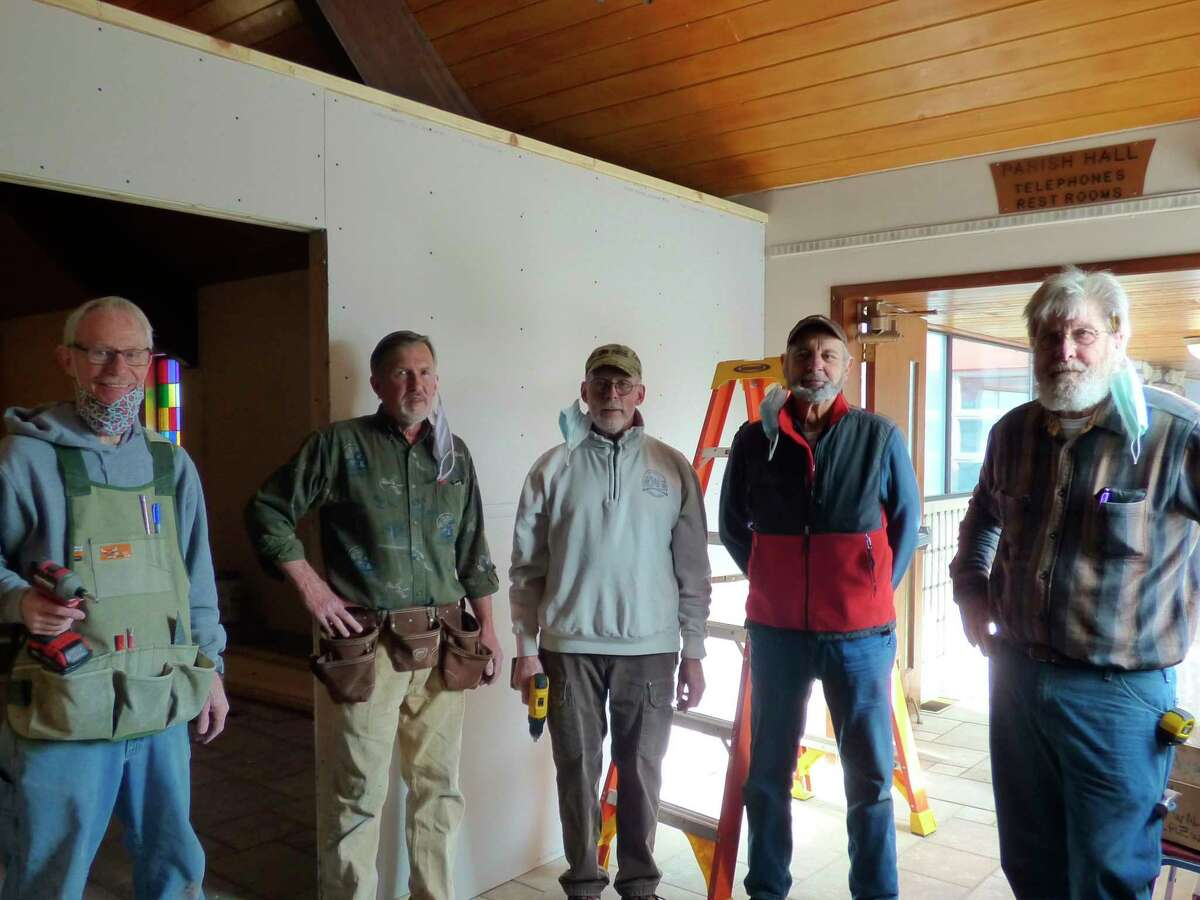 Habitat for Humanity volunteers (from left) Mick Szymanski, Bruce Fredrickson, Steve Rogers, Barry Elder and Paul Glaser installed and painted walls at the Wagoner Community Center in Manistee this week fora meditative area. (Scott Fraley/News Advocate)