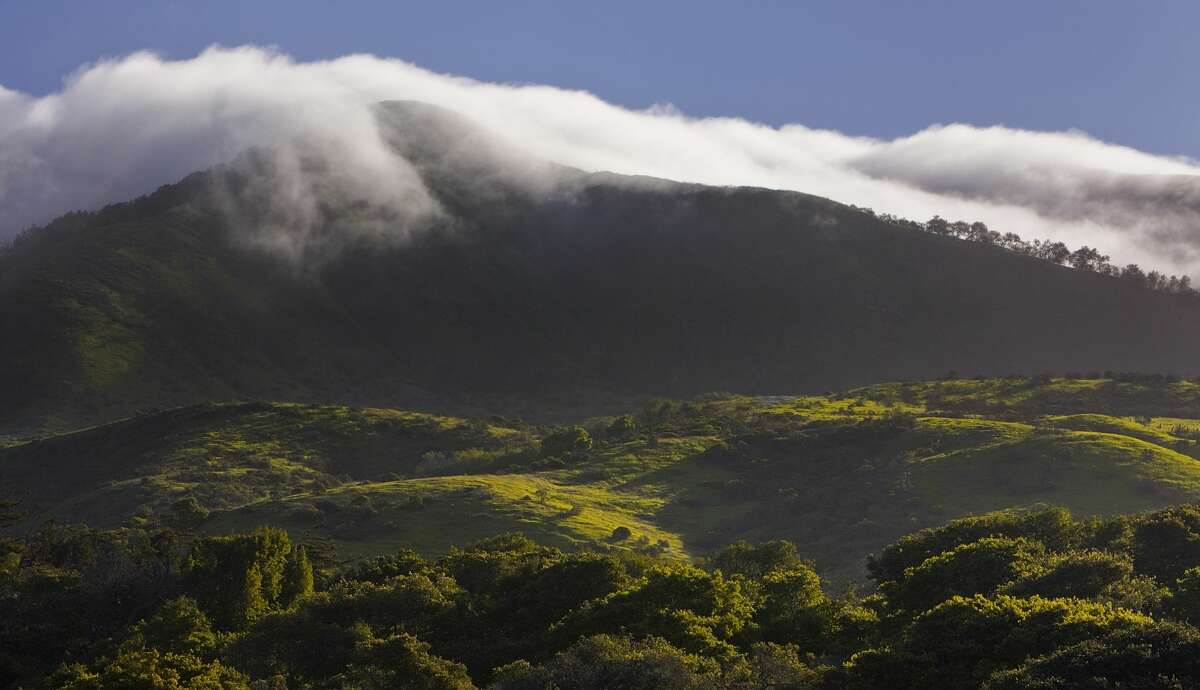 Spring fog pours over the Santa Lucia Mountains near Carmel, Calif.