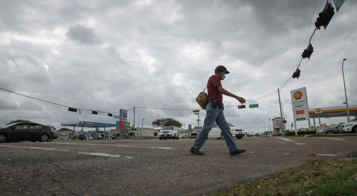 A man uses the crosswalk at the intersection of Fondren and West Bellfort on March 9, 2021, in Houston. The region's streets are among the riskiest for pedestrians, according to a new report.