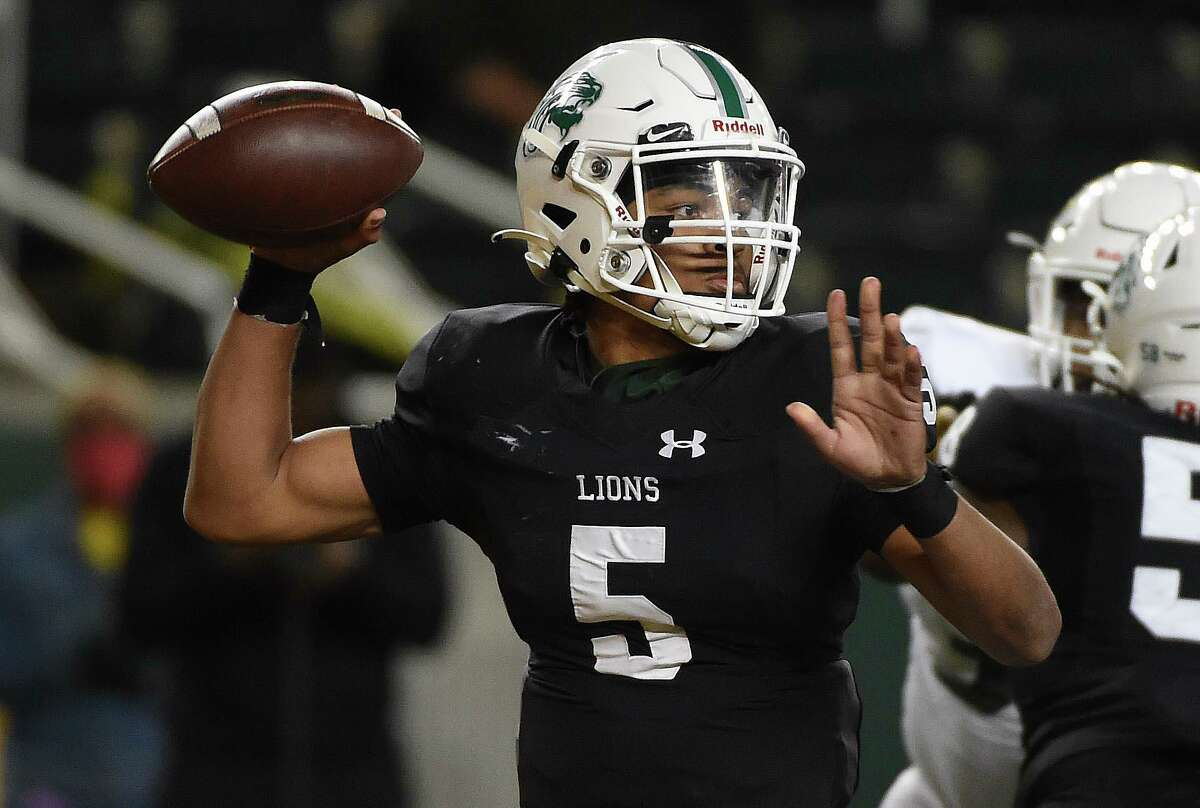 Spring quarterback Bishop Davenport throws a pass during the first half of a 6A Division I Region II regional semi-final high school football playoff game against DeSoto, Saturday, Dec. 26, 2020, in Waco, TX.